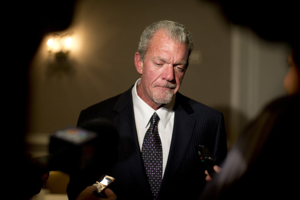 Photo - FILE - In this Oct. 8, 2013 file photo, Indianapolis Colts owner Jim Irsay pauses as he speaks to reporters following the NFL owners' fall meetings in Washington. Authorities say Irsay is in jail after being stopped on suspicion of drunken driving. Hamilton County Sheriff's Department Deputy Bryant Orem says Irsay was arrested Sunday night, March 16, 2014, in the northern Indianapolis suburb of Carmel. (AP Photo/Carolyn Kaster, File)
