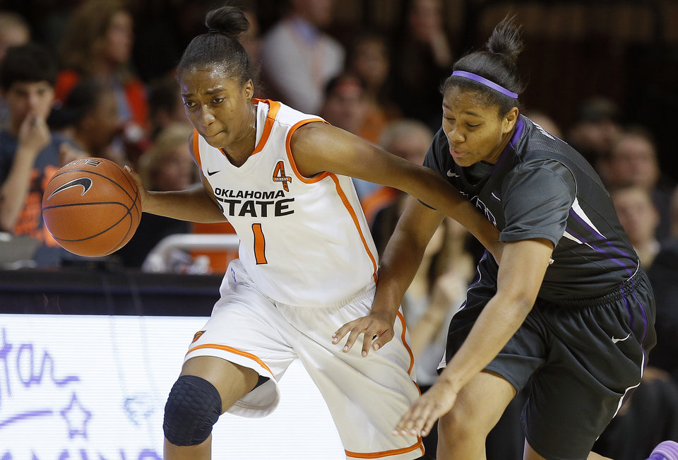 Oklahoma State's Brittany Atkins (1) goes past TCU's Veja Hamilton (3) during a women's NCAA college basketball game between Oklahoma State University (OSU) and TCU at Gallagher-Iba Arena in Stillwater, Okla., Tuesday, Jan. 14, 2014.  Photo by Bryan Terry, The Oklahoman