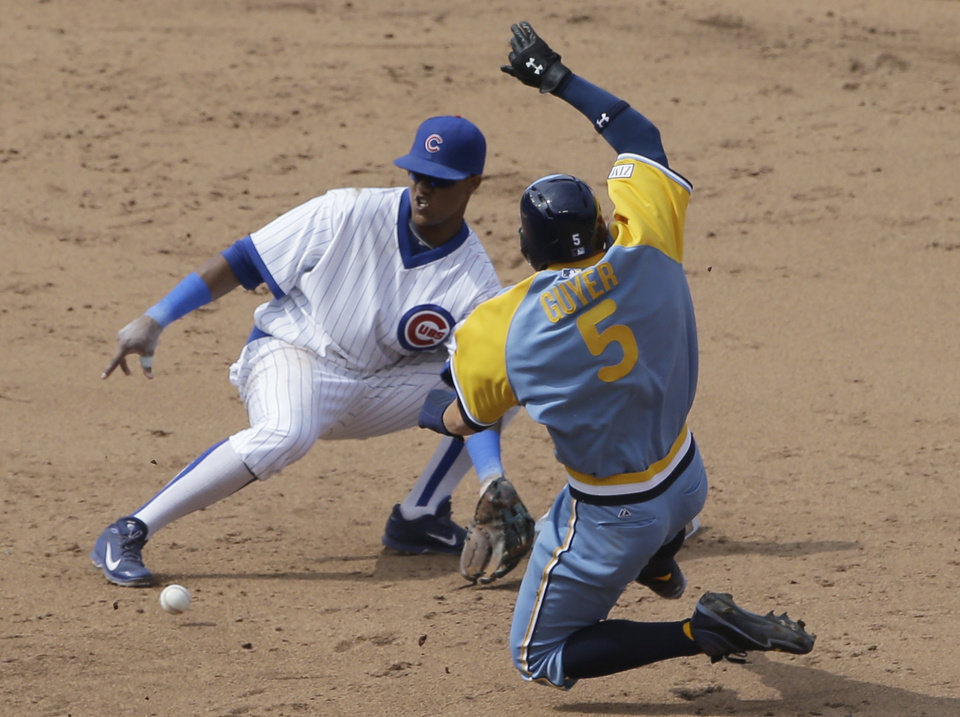 Photo - Tampa Bay Rays' Brandon Guyer, right, steals second base as Chicago Cubs shortstop Starlin Castro waits for the ball during the seventh inning of an interleague baseball game in Chicago, Sunday, Aug. 10, 2014. (AP Photo/Nam Y. Huh)