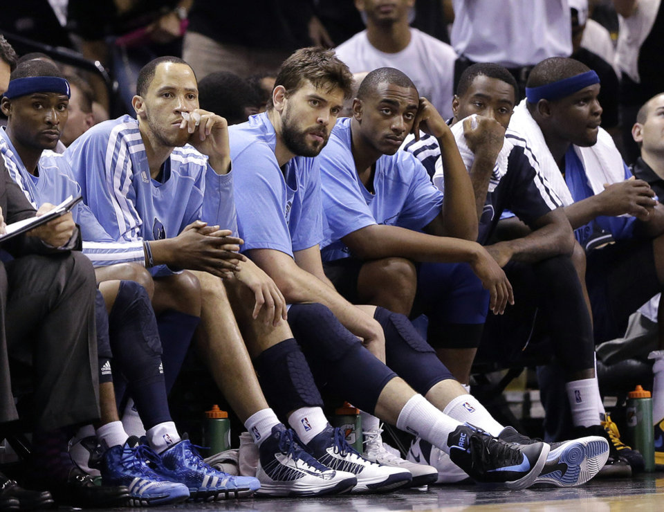 Photo - Memphis Grizzlies players sit on the bench during the second half in Game 1 of a Western Conference Finals NBA basketball playoff series against the San Antonio Spurs, Sunday, May 19, 2013, in San Antonio. The Spurs won 105-83. (AP Photo/Eric Gay)