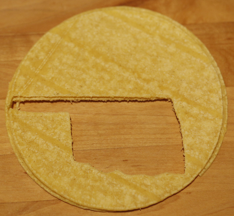 Photo - Sherrel Jones uses a cookie cutter to make Oklahoma-shaped tortilla chips.