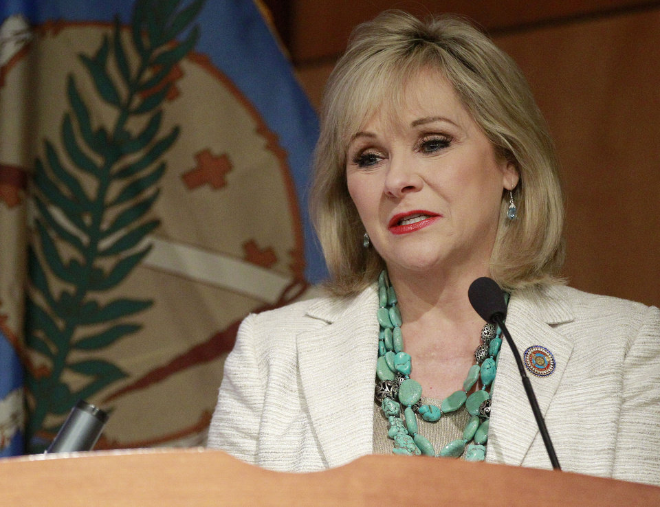 Oklahoma Gov. Mary Fallin addresses a group on natural gas vehicles in Oklahoma City, Wednesday, Aug. 8, 2012. Officials with automobile manufacturers, converters and dealers are meeting in Oklahoma City to discuss a request for proposal from nearly two dozen states for the nation\'s auto makers to produce natural gas-powered vehicles for state fleets. (AP Photo/Sue Ogrocki)