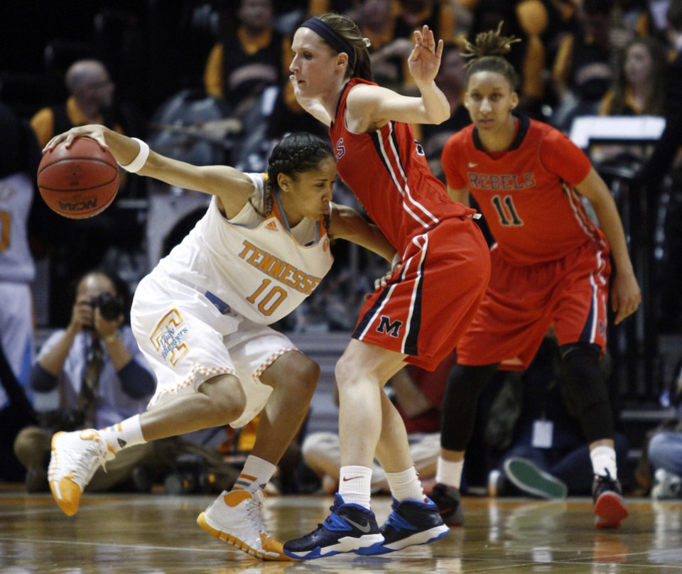 Photo - Tennessee guard Meighan Simmons (10) collides with Mississippi guard Gracie Frizzell during the second half of an NCAA college basketball game Thursday, Jan. 9, 2014, in Knoxville, Tenn. Mississippi forward Kenyotta Jenkins is at right. Tennessee won 94-70. (AP Photo/Wade Payne)