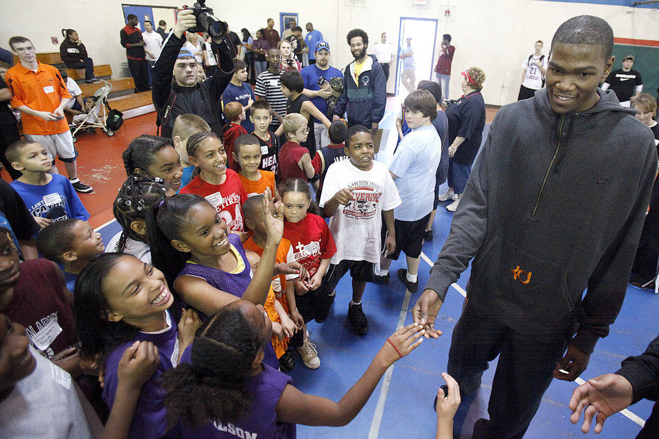 Kevin Durant greets players during the Nike Clinic at the Salvation Army Boy and Girls Club, Saturday, Feb. 7, 2009, in Oklahoma City. PHOTO BY SARAH PHIPPS, THE OKLAHOMAN