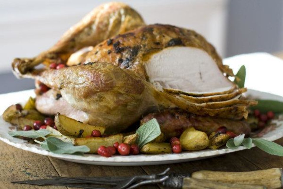 Photo - This turkey recipe uses minced fresh sage to softened butter, which then is rubbed both under and over the bird's skin.  Matthew Mead - AP