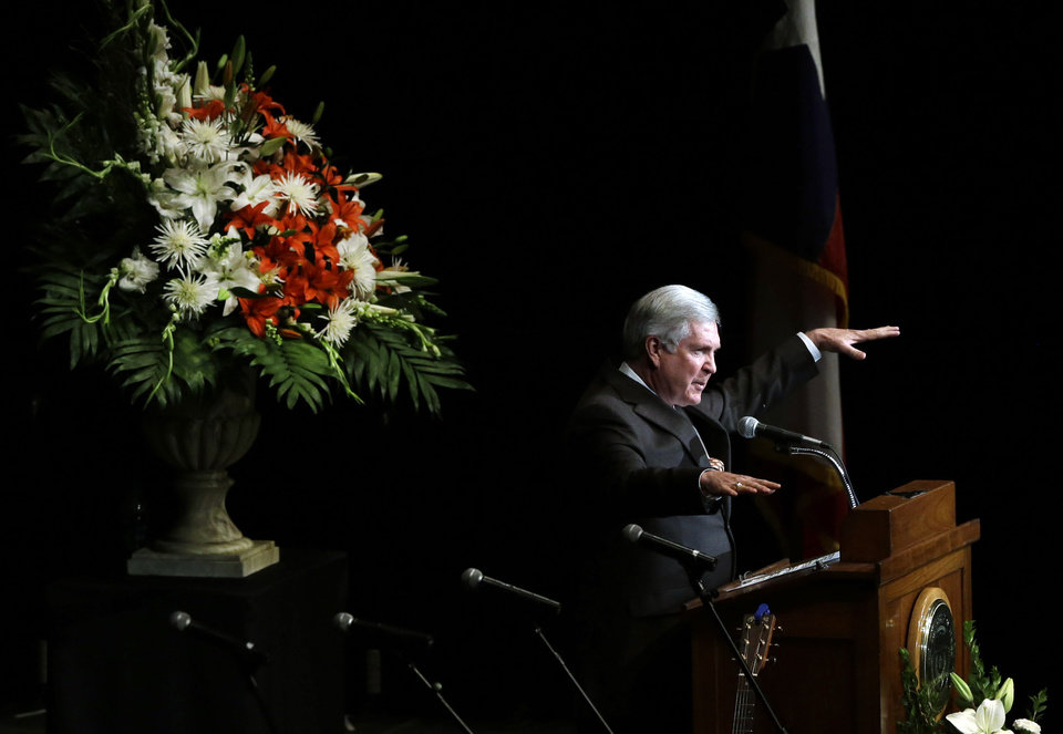 Texas coach Mack Brown speaks during a public memorial for former Texas football coach Darrell K. Royal , Tuesday, Nov. 13, 2012, in Austin, Texas. Royal, the coach who led Texas to two national championships and revolutionized college football with the introduction of the wishbone in 1968, died Nov. 7 at age 88. (AP Photo/Eric Gay)