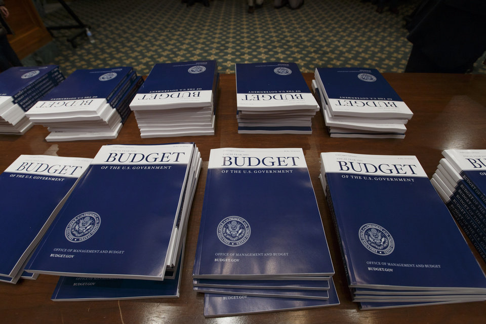 Photo - Copies of President Barack Obama's proposed fiscal 2015 budget are set out for distribution by the Senate Budget Committee on Capitol Hill in Washington, Tuesday, March 4, 2014. President Barack Obama is unwrapping a nearly $4 trillion budget that gives Democrats an election-year playbook for fortifying the economy and bolstering Americans' incomes. It also underscores how pressure has faded to launch bold, new attacks on federal deficits.  (AP Photo/J. Scott Applewhite)
