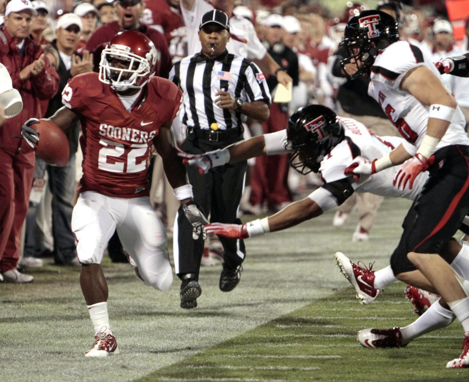 Photo - Oklahoma's Roy Finch (22) is pushed out of bounds after a 53 yard run during the first half of the college football game between the University of Oklahoma Sooners (OU) and Texas Tech University Red Raiders (TTU) at the Gaylord Family-Memorial Stadium on Saturday, Oct. 22, 2011. in Norman, Okla. Photo by Steve Sisney, The Oklahoman