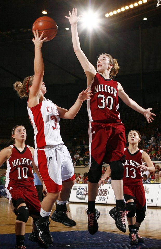 Photo - Cache's Taylor Thompson (33) tries to get a shot past Debra Silva (30) of Muldrow as Fallon Tate (10) and Teala Cormier (13) look on during 4A girls semifinal game between Muldrow and Cache in the Oklahoma High School Basketball Championships at State Fair Arena in Oklahoma City, Friday, March 13, 2009. Cache won to advance to the championship game. PHOTO BY NATE BILLINGS, THE OKLAHOMAN