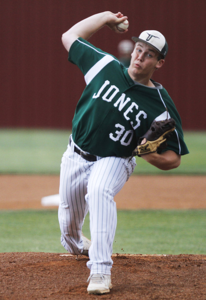 Photo - Jones pitcher Austin Hoover (30) pitches during a Class 3A baseball state game between Jones and Kansas at Edmond Memorial High School, Thursday, May 15, 2014, in Edmond. Photo by KT King, For The Oklahoman