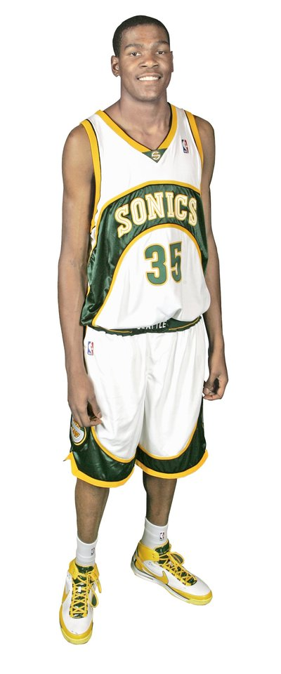 Photo - Seattle SuperSonics' Kevin Durant poses for a photo on NBA basketball media day Monday, Oct. 1, 2007 in Seattle. (AP Photo/Ted S. Warren) ORG XMIT: NYEOTK ORG XMIT: 0710272213324919