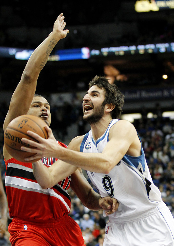 Photo - Minnesota Timberwolves Ricky Rubio (9) drives on Portland Trail Blazers Earl Watson in the first quarter of their NBA basketball game on Saturday, Feb. 8, 2014 in Minneapolis.(AP Photo/Andy Clayton-King)