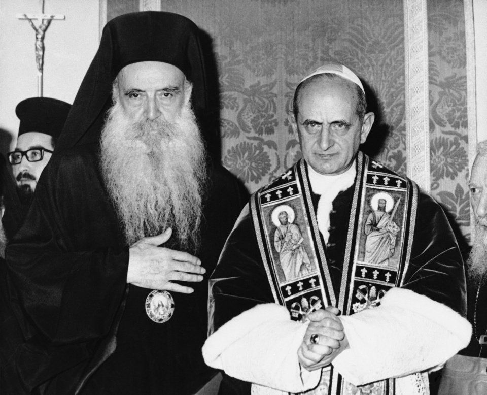 "Photo - FILE -- In this file photo taken on Jan. 5, 1964, Pope Paul VI, right, and orthodox Patriarch Athenagoras of Constantinople pose at their historic meeting at the apostolic delegation's headquarters on the Mount of Olives in Jerusalem, Jordan. The iconic 1964 embrace between the diminutive Paul and the six-foot-tall, bearded Patriarch of Constantinople ended 900 years of mutual excommunications and divisions between Catholic and Orthodox stemming from the Great Schism of 1054, which split Christianity. Pope Francis insists his weekend pilgrimage to the Middle East is a ""strictly religious"" commemoration of a key turning point in Catholic-Orthodox relations. But the three-day visit is the most delicate mission of his papacy and will test his diplomatic chops as he negotiates Israeli-Palestinian tensions and fallout from Syria's civil war. (AP Photo)"