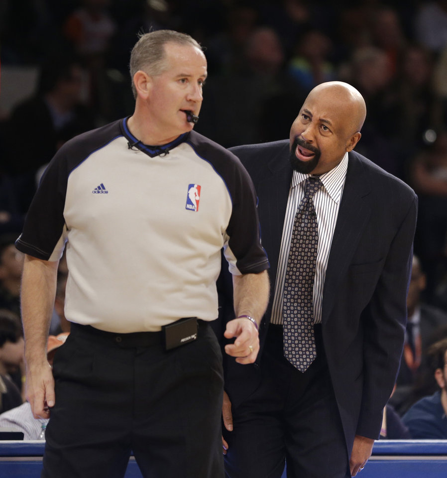Photo - New York Knicks' head coach Mike Woodson, right, yells at a referee during the first half of the NBA basketball game against the Brooklyn Nets at Madison Square Garden, Monday, Jan. 20, 2014, in New York. (AP Photo/Seth Wenig)