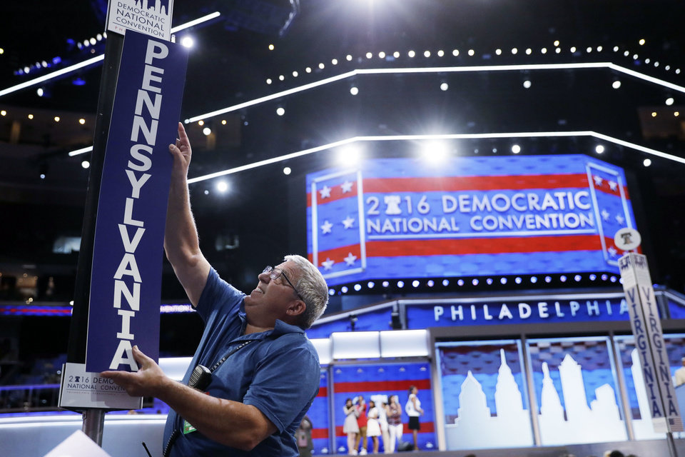 Photo - Jimmy Wright installs the Pennsylvania delegation placard ahead of the 2016 Democratic National Convention in Philadelphia, Sunday, July 24, 2016. (AP Photo/Matt Rourke)