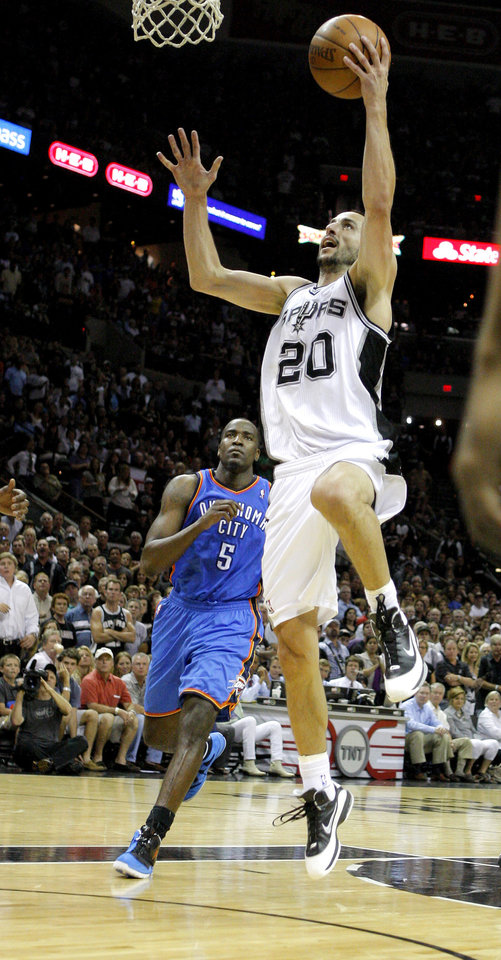 San Antonio's Manu Ginobili (20) goes past Oklahoma City's Kendrick Perkins (5) during Game 1 of the Western Conference Finals between the Oklahoma City Thunder and the San Antonio Spurs in the NBA playoffs at the AT&T Center in San Antonio, Texas, Sunday, May 27, 2012. Oklahoma City lost 101-98. Photo by Bryan Terry, The Oklahoman