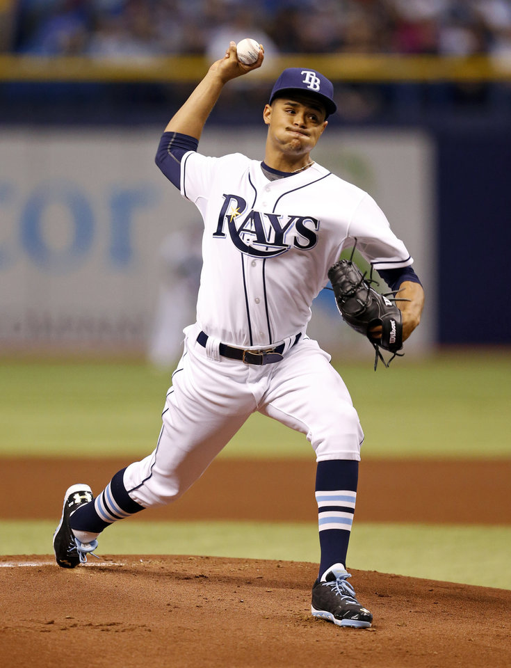 Photo - Tampa Bay Rays starting pitcher Chris Archer throws during the first inning of a baseball game against the New York Yankees, Saturday, April 19, 2014, in St. Petersburg, Fla. (AP Photo/Mike Carlson)