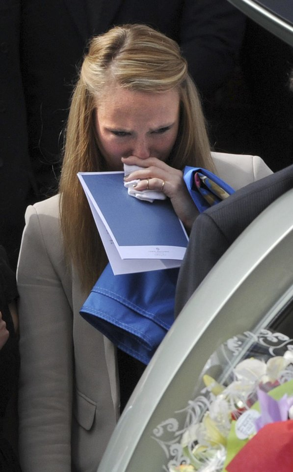 Photo - Sarah Harper, the girlfriend of Christopher Lane, looks into the funeral hearse at St. Therese's Church in Melbourne, Australia, Wednesday. (AP Photo/AAP Image, Julian Smith)  Julian Smith - AP