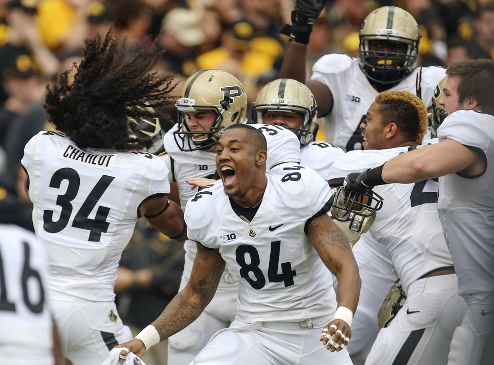 Purdue players including Justin Sinz (84) celebrate after kicker Paul Griggs (37) kicked the game-winning 46-yard field goal against Iowa late as time expired in the second half of an NCAA college football game Saturday, Nov. 10, 2012, in Iowa City, Iowa. Purdue won 27-24. (AP Photo/The Gazette, Liz Martin)