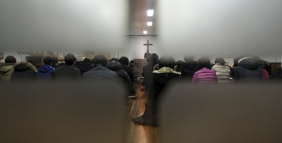 Photo - Members from Jincheon Jungang Presbyterian Church attend a service at their church in Jincheon, South Korea, Monday, Feb. 17, 2014. A bombing that killed three South Koreans and an Egyptian driver on the Sinai Peninsula targeted a bus filled with Korean members from the church who had saved for years to visit sites mentioned in the Bible on their church's 60th anniversary, officials said Monday. (AP Photo/Yonhap, Kim Hyung-woo) KOREA OUT