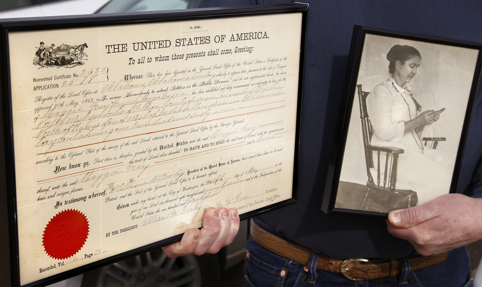 Photo -  Wendell Gray holds a picture of his grandmother and the certificate of homestead issued to Maggie (Gossin) Gray in May 1897. It was signed by President William McKinley.   Jim Beckel -  THE OKLAHOMAN