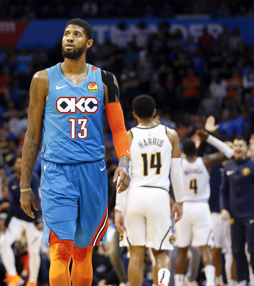 Photo - Oklahoma City's Paul George (13) walks to the bench for a timeout after Denver's Paul Millsap (4) hit a three-point shot in the final minute of the fourth quarter during an NBA basketball game between the Denver Nuggets and the Oklahoma City Thunder at Chesapeake Energy Arena in Oklahoma City, Friday, March 29, 2019. Denver won 115-105. Photo by Nate Billings, The Oklahoman