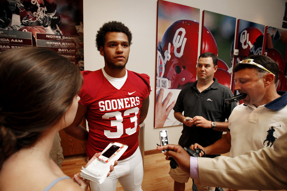 Photo - Trey Millard (33) speaks with the media during the Meet the Sooners event at the University of Oklahoma on Saturday, Aug. 4, 2012, in Norman, Okla.  Photo by Steve Sisney, The Oklahoman