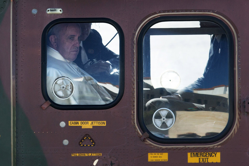 Photo - Pope Francis, onboard a Jordanian military helicopter, arrives in the West Bank town of Bethlehem on Sunday, May 25, 2014. Francis landed Sunday in the West Bank town of Bethlehem in a symbolic nod to Palestinian aspirations for their own state as he began a busy second day of his Mideast pilgrimage. (AP Photo/Menahem Kahana, Pool)