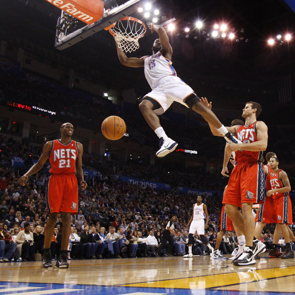 Oklahoma City\'s James Harden dunks the ball between New Jersey\'s Travis Outlaw, left, and Kris Humphries during the NBA basketball game between the Oklahoma City Thunder and the New Jersey Nets at the Oklahoma City Arena, Wednesday, Dec. 29, 2010. Photo by Bryan Terry, The Oklahoman