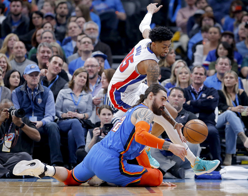 Photo - Oklahoma City's Steven Adams (12) goes for a loose ball as Detroit's Christian Wood (35) defends during NBA basketball game between the Oklahoma City Thunder and the Detroit Pistons at the Chesapeake Energy Arena in Oklahoma City, Friday, Feb. 7, 2020.  [Sarah Phipps/The Oklahoman]