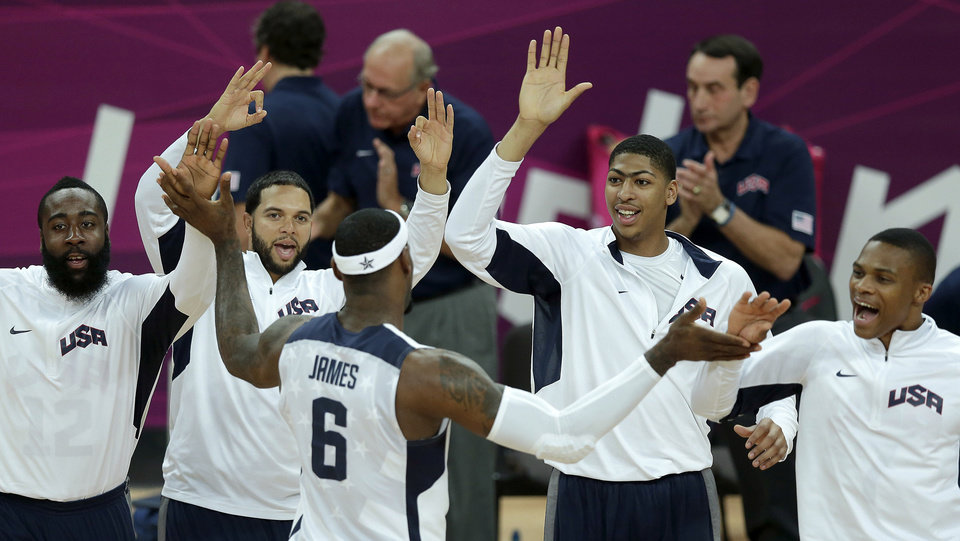 Photo -   United States' Lebron James (6) celebrates with teammates during a men's basketball game against Nigeria at the 2012 Summer Olympics, Thursday, Aug. 2, 2012, in London. (AP Photo/Charlie Riedel)