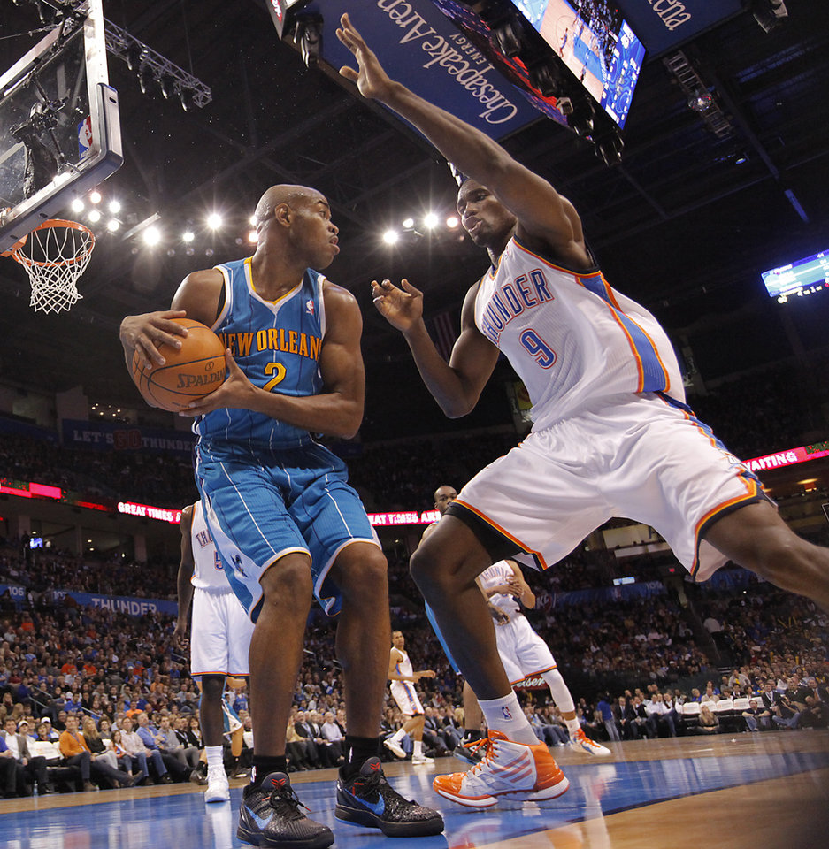 Photo - Oklahoma City Thunder power forward Serge Ibaka (9) defends on New Orleans Hornets point guard Jarrett Jack (2) during the NBA basketball game between the Oklahoma City Thunder and the New Orleans Hornets at the Chesapeake Energy Arena on Wednesday, Jan. 25, 2012, in Oklahoma City, Okla. Photo by Chris Landsberger, The Oklahoman