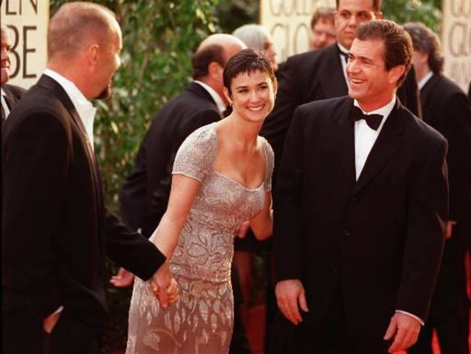 "Actor Mel Gibson, right, greets actress Demi Moore and her husband Bruce Willis at the 54th annual Golden Globe Awards, Sunday, Jan. 19, 1997, in Beverly Hills, Calif.  Gibson was nominated for Best Actor in a Drama for his work in the film ""Ransom"" while Moore garnered a nomination for Best Actress in a Mini-Series or Movie Made for Television for her work in ""If These Walls Could Talk.""  (AP Photo/Chris Pizzello)"