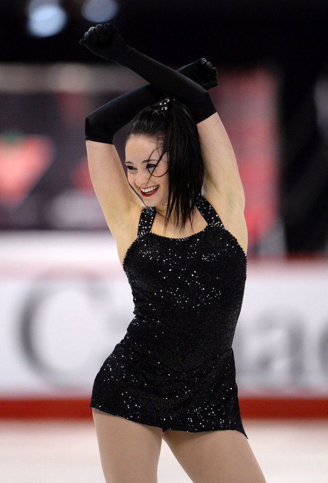Photo - Kaetlyn Osmond smiles at the judges as she completes her short program at the Canadian figure skating championships Friday Jan. 10, 2014 in Ottawa. (AP Photo/The Canadian Press, Sean Kilpatrick)