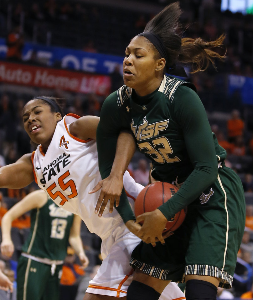 Oklahoma State's LaShawn Jones (55) and South Florida's Akila McDonald (32) go for a rebound during the All-College Classic women's basketball game between Oklahoma State University and South Florida at Chesapeake Energy Arena in Oklahoma City, Okla., Saturday, Dec. 14, 2013. Photo by Bryan Terry, The Oklahoman