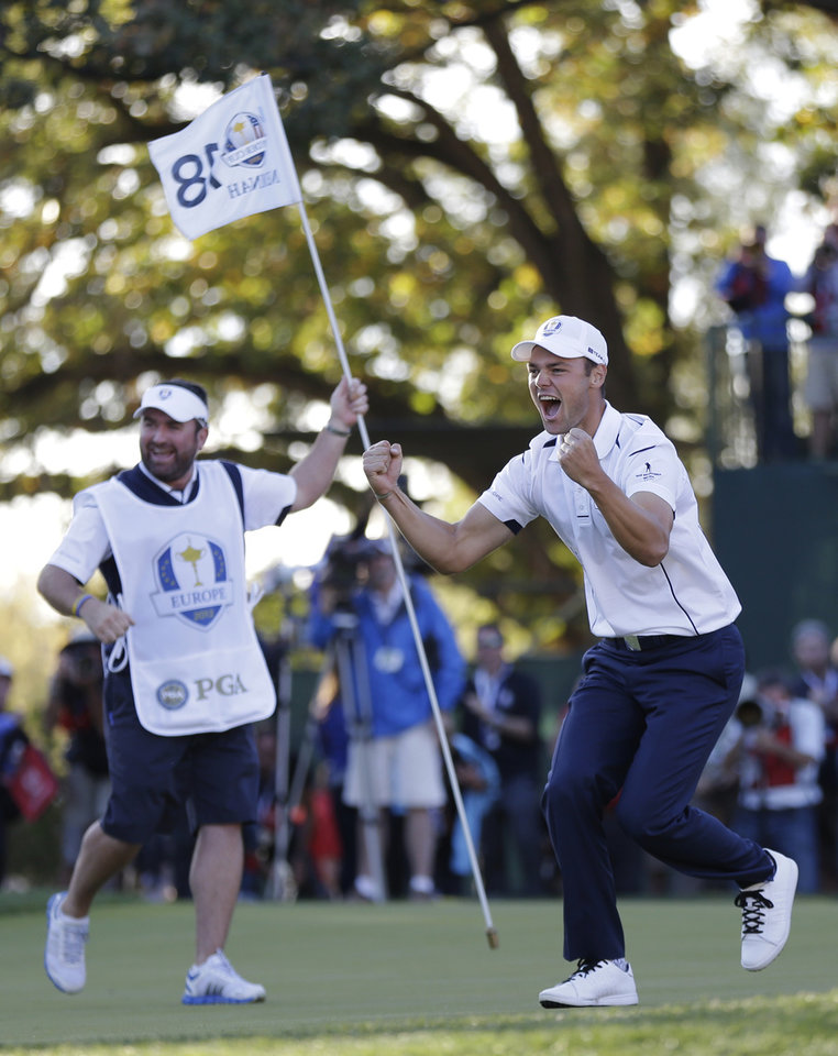 Europe's Martin Kaymer celebrates after winning the Ryder Cup PGA golf tournament Sunday, Sept. 30, 2012, at the Medinah Country Club in Medinah, Ill. (AP Photo/David J. Phillip)  ORG XMIT: PGA203