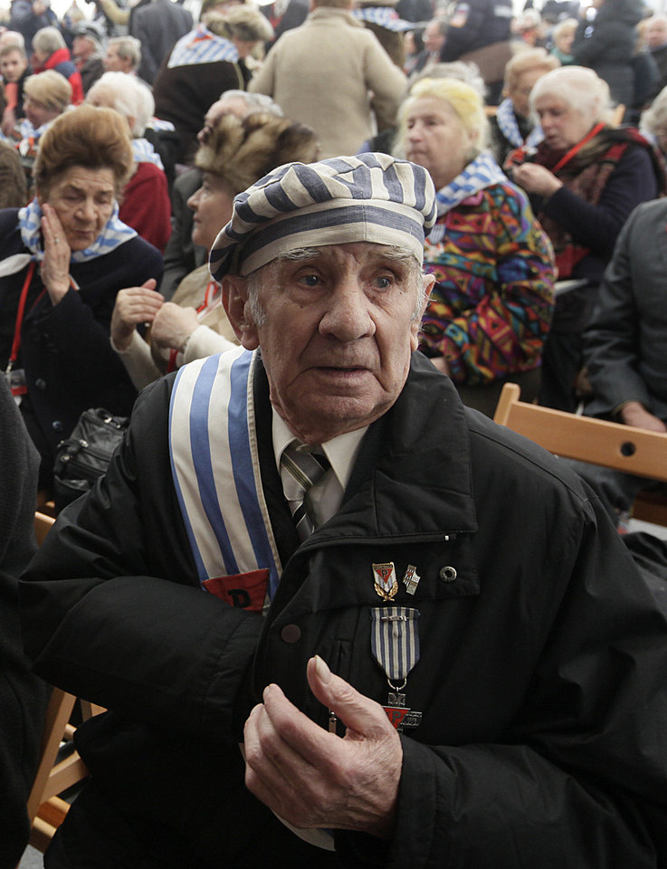 Photo - Former prisoner Miroslaw Celka, 89, attends a ceremony at  the Auschwitz concentration camp  in Oswiecim, Poland, Sunday, Jan. 27, 2013,  marking the 68th anniversary of the liberation of Auschwitz by Soviet troops and  remembering  the victims of the Holocaust, in Auschwitz-Birkenau.  (AP Photo/Czarek Sokolowski)
