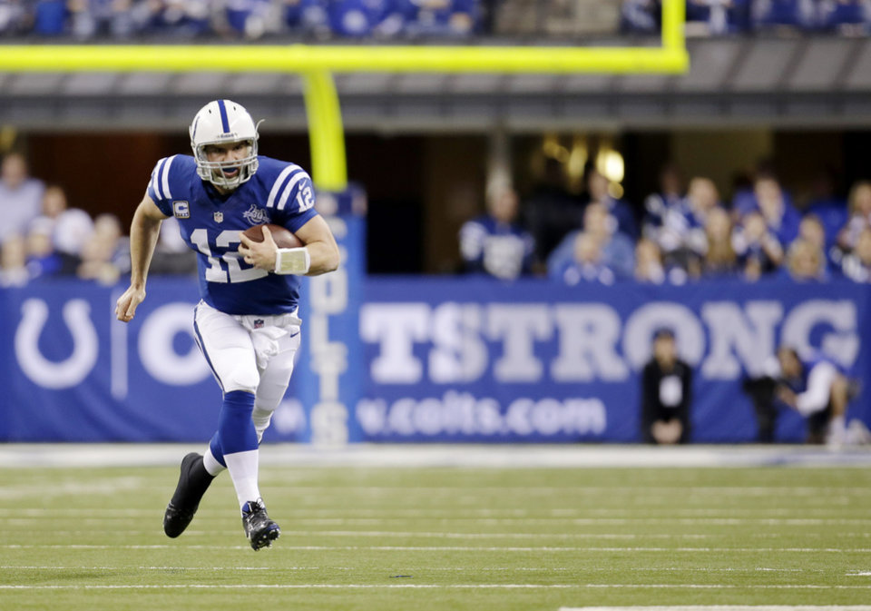 Photo - Indianapolis Colts quarterback Andrew Luck (12) runs the ball against the Kansas City Chiefs during the first half of an NFL wild-card playoff football game Saturday, Jan. 4, 2014, in Indianapolis. (AP Photo/AJ Mast)