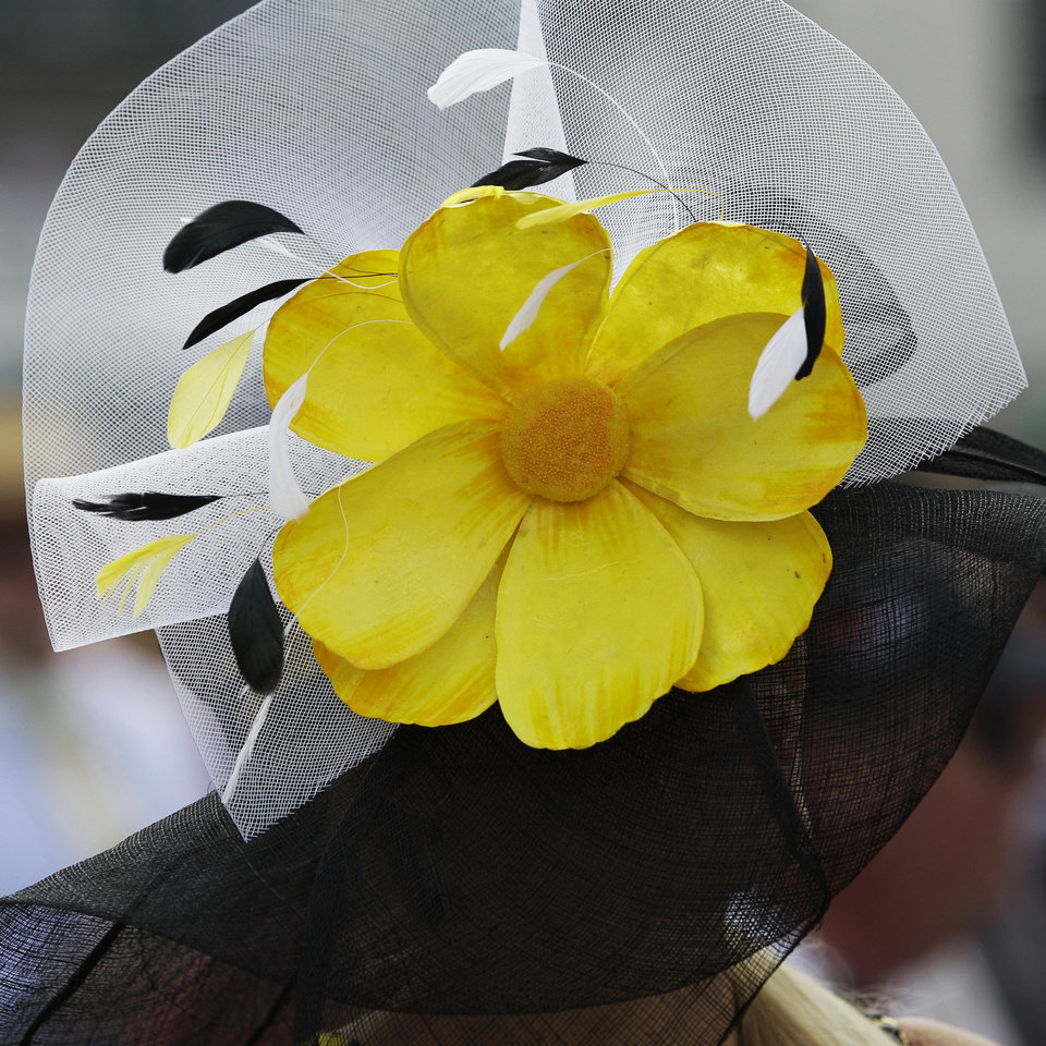 Photo - A spectator wears a fancy hat before the 138th Kentucky Derby horse race at Churchill Downs Saturday, May 5, 2012, in Louisville, Ky. (AP Photo/David J. Phillip)  David J. Phillip - AP