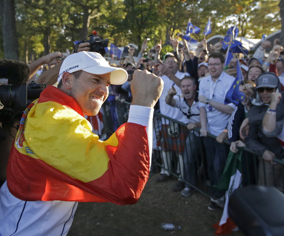 Europe's Sergio Garcia celebrates after winning the Ryder Cup PGA golf tournament Sunday, Sept. 30, 2012, at the Medinah Country Club in Medinah, Ill. (AP Photo/Chris Carlson)  ORG XMIT: PGA211