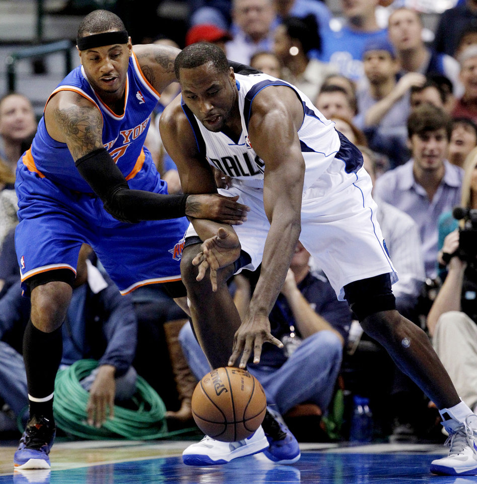 Photo -   New York Knicks ll forward Carmelo Anthony (7) strips the ball away from Dallas Mavericks' Elton Brand (42) in the first half of an NBA basketball game, Wednesday, Nov. 21, 2012, in Dallas. (AP Photo/Tony Gutierrez)