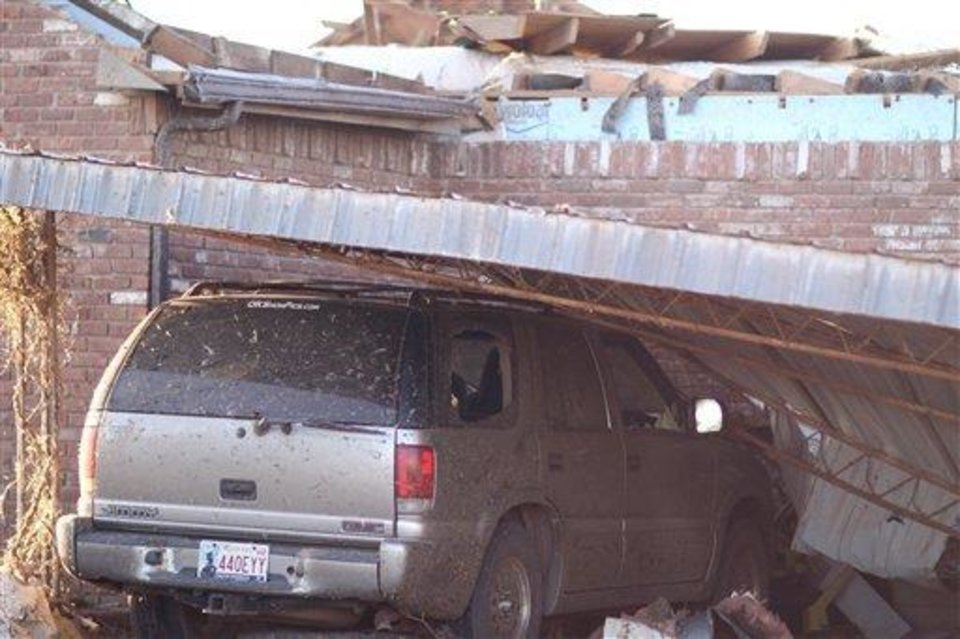 Photo - In this Tuesday, March 9, 2010 photo provided by John W. Cannon of the Elk City Daily News, a damaged SUV is shown after a Tornado struck Hammon, Okla. on Monday. (AP Photo/Elk City Daily News, John W. Cannon)