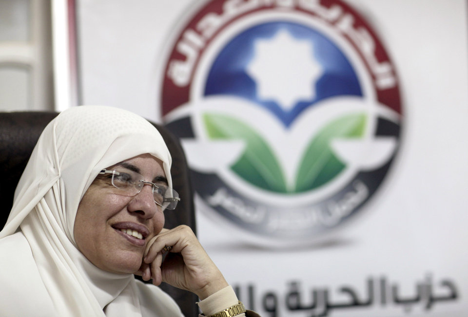 In this Wednesday, Oct. 9, 2012 photo, Azza el-Gharf of the Muslim Brotherhood's Freedom and Justice Party speaks to the Associated Press at the party's office in Cairo, Egypt. El-Garf, a 47-year-old mother of seven who joined the Brotherhood when she was 15, said that a woman�s role in her family need not contradict with her participation in politics, saying that she balances these two responsibilities. The rise of the Muslim Brotherhood to power in Egypt has brought with it a new group of female politicians who say they are determined to bring more women into leadership roles _ and at the same time want to consecrate a deeply conservative Islamic vision for women in Egypt.(AP Photo/Maya Alleruzzo)
