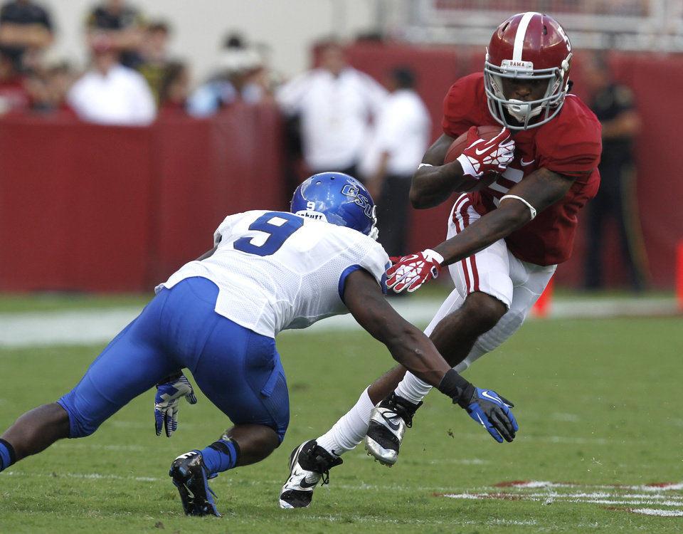 Alabama wide receiver Chris Black (5) tries to get around Georgia State cornerback Brent McClendon (9) after catching a pass for a first down during the second half of an NCAA college football game on Saturday, Oct. 5, 2013, in Tuscaloosa, Ala. (AP Photo/Butch Dill)