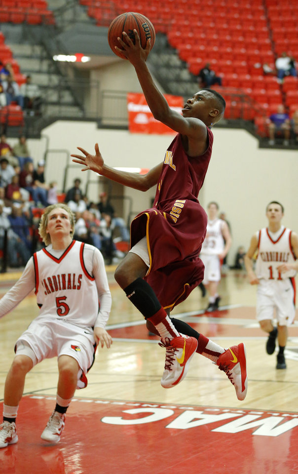 Photo - Centennial's Malcolm Mitchell goes to the basket past Dakota Brasher of Verdigris during a Class 3A boys state basketball tournament game between Centennial and Verdigris at Yukon High School in Yukon, Okla., Thursday, March 7, 2013. Photo by Bryan Terry, The Oklahoman