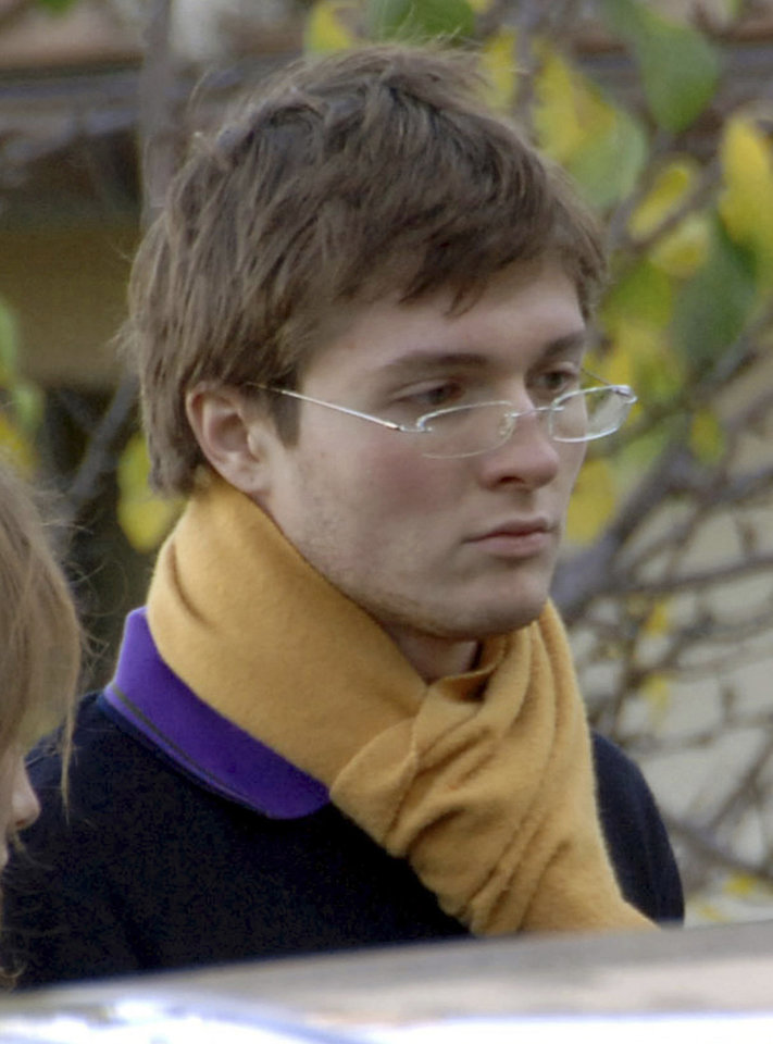 Photo - FILE - In this Nov. 2, 2007 file photo, Italian student Raffaele Sollecito, then boyfriend of American student Amanda Knox, stands outside the rented house where 21-year-old British student Meredith Kercher was found dead on Nov 1, in Perugia, Italy. Few international criminal cases have cleaved along national biases as that of American student Amanda Knox, awaiting half world away her third Italian court verdict in the 2007 slaying of her British roommate Kercher. Whatever is decided this week, the protracted legal battle that has grabbed global headlines and polarized trial-watchers in three nations probably won't end in Florence. With the first two trials producing flip-flop guilty-then-innocent verdicts against Knox and her former Italian boyfriend, Raffaele Sollecito, the case has produced harshly clashing versions of events. A Florence appeals panel designated by Italy's supreme court to address errors in the appeals acquittal is set to deliberate Thursday, Jan. 30, 2014, with a verdict expected later in the day. .(AP Photo/Stefano Medici, file)