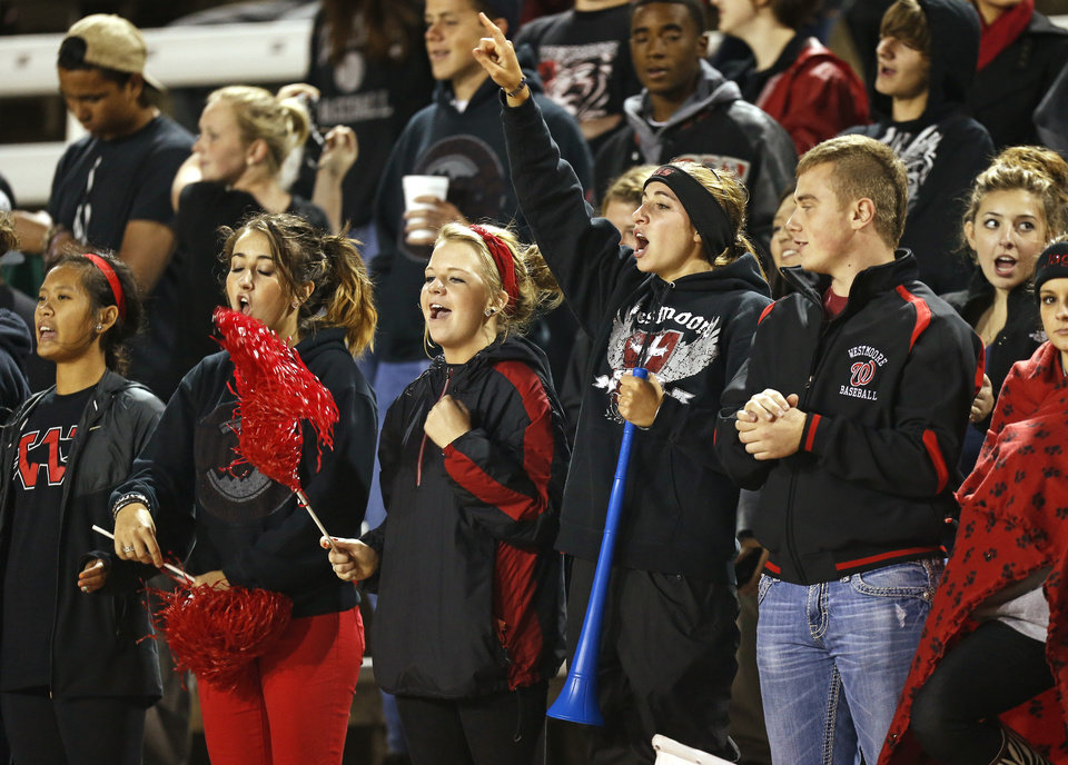 Photo - Westmoore fans cheer during a high school football game between Westmoore and Norman North in Moore, Okla., Thursday, September 13, 2012. Photo by Bryan Terry, The Oklahoman