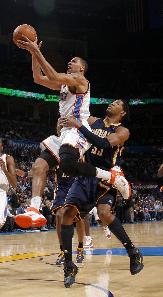 Photo - Oklahoma City's Thabo Sefolosha (2) is fouled by Indiana's Indiana's Danny Granger (33) during the NBA basketball game between the Oklahoma City Thunder and the Indiana Pacers at the Oklahoma City Arena, Wednesday, March 2, 2011. Photo by Bryan Terry, The Oklahoman