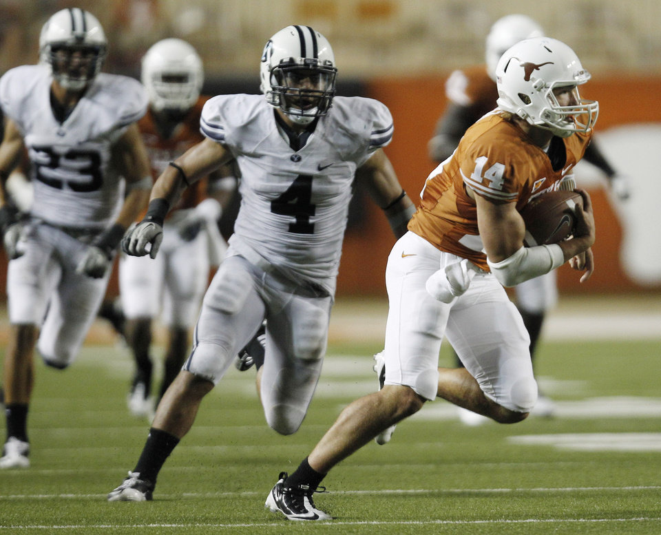 Photo - Texas quarterback David Ash (14) is pursued BYU's Uona Kaveinga (4) after he catching a pass from wide receiver Jaxon Shipley during the fourth quarter on an NCAA college football game, Saturday, Sept. 10, 2011, in Austin, Texas. (AP Photo/Eric Gay) ORG XMIT: TXEG112