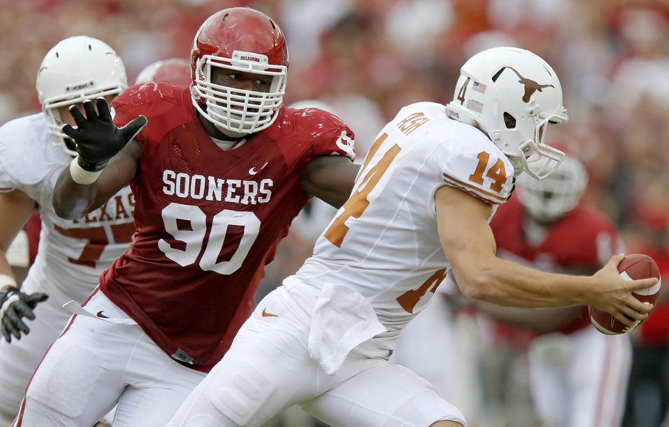OU\'s David King (90) chases after UT\'s David Ash (14) during the Red River Rivalry college football game between the University of Oklahoma (OU) and the University of Texas (UT) at the Cotton Bowl in Dallas, Saturday, Oct. 13, 2012. Oklahoma won 63-21. Photo by Bryan Terry, The Oklahoman